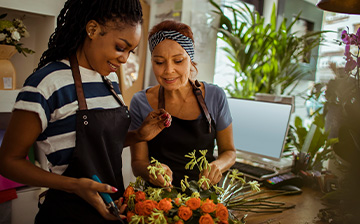 Two women working in a flower shop